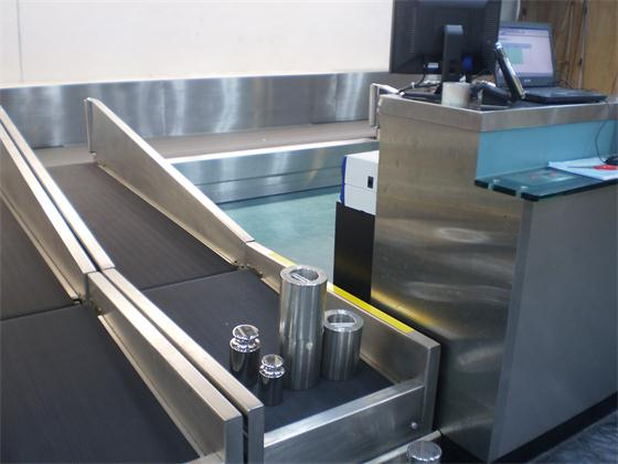 Calibration of airport luggage weighing scale.JPG